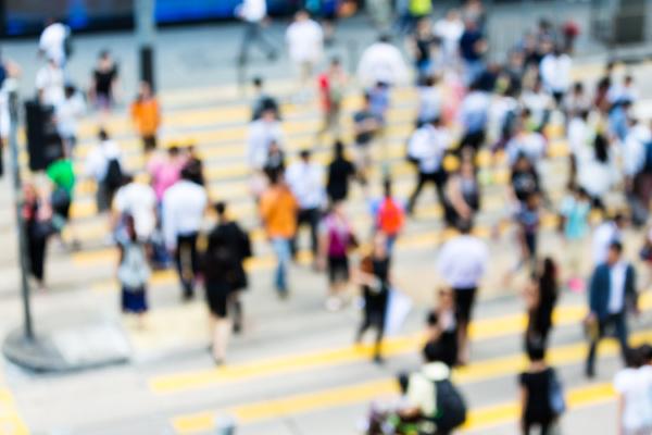 blur view of crosswalk and pedestrian
