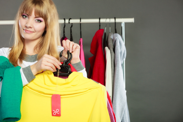 woman holding discount label sale