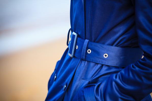 female fashion closeup blue coat