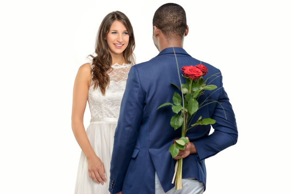 african man gives roses to his