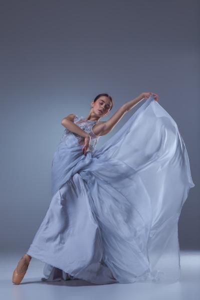 the beautiful ballerina dancing in blue