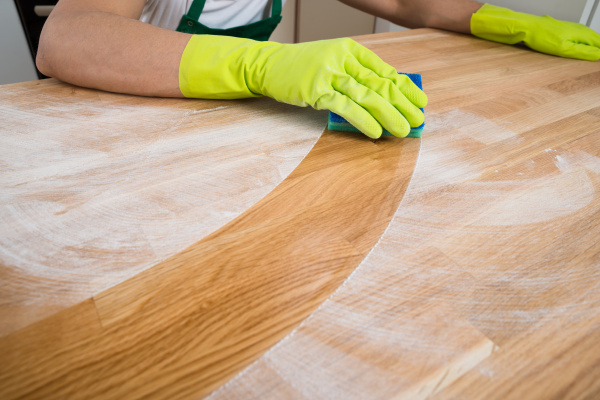 man, cleaning, dust, on, wooden, table - 15361099