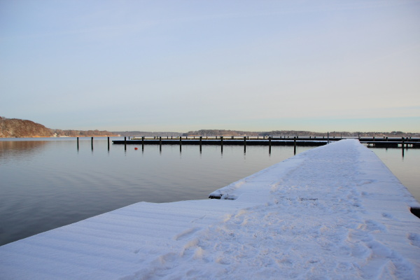 cold winter lake with snow on