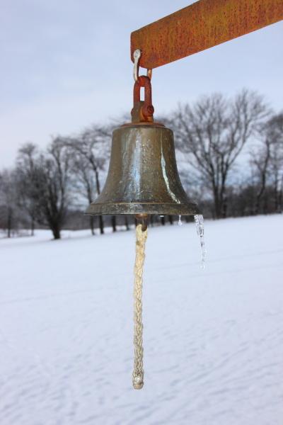 metal bell with winter snowy fields