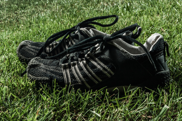 pair of black sport shoes on