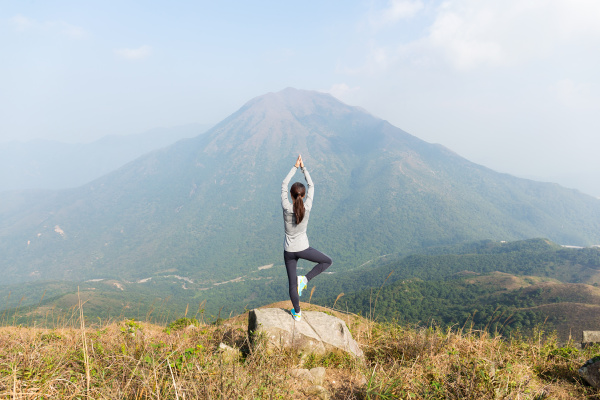 asian woman do yoga at the