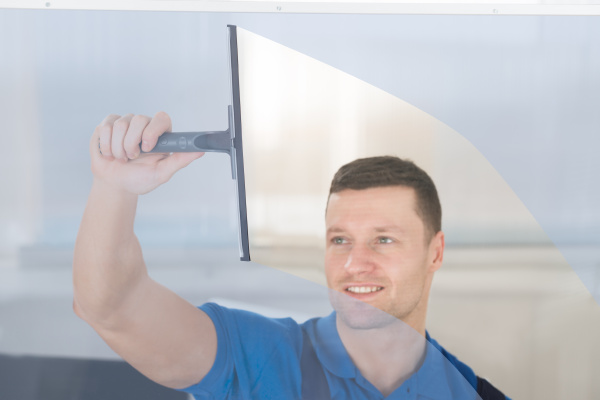 worker, cleaning, glass, window, with, squeegee - 15929691
