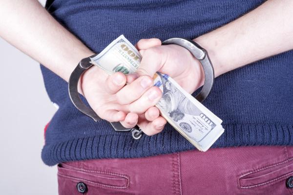 elegant businessman in handcuffs