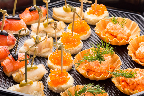 closeup set different canapes and snacks