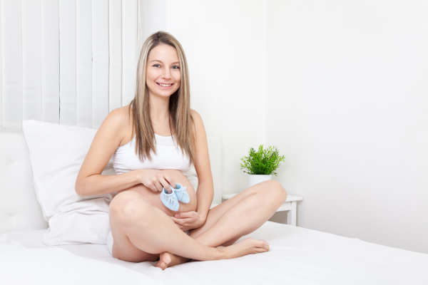 pregnant, woman, relaxing, on, the, bed - 16324453