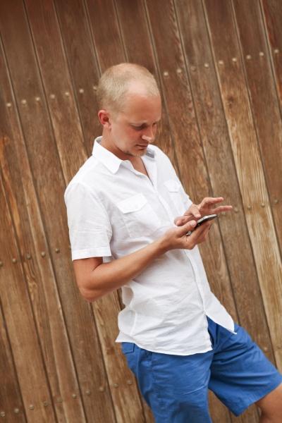 spain mallorca man using his smartphone