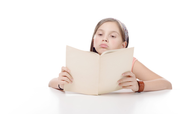 preteen, girl, reads, a, book, , on - 16339415