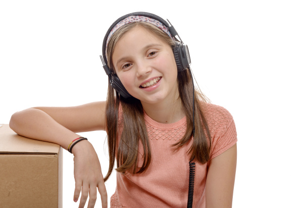 preteen, listening, to, music, with, headphones - 16339391