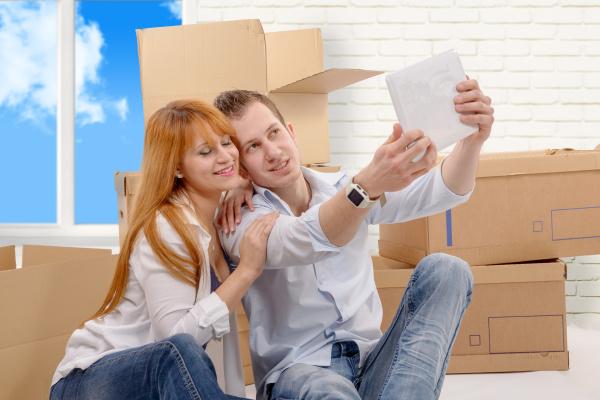 happy, couple, sitting, on, the, floor - 16357251