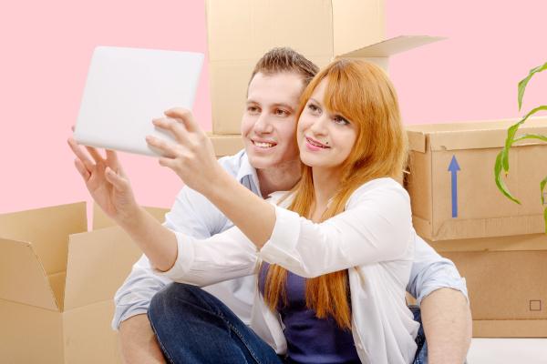 happy, couple, sitting, on, the, floor - 16357271