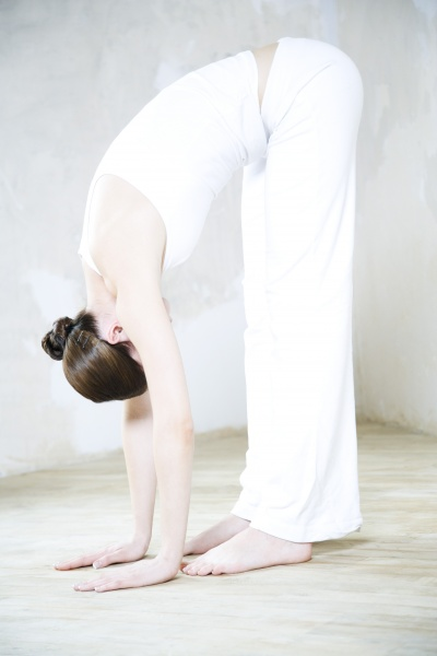 woman bending over touching toes full