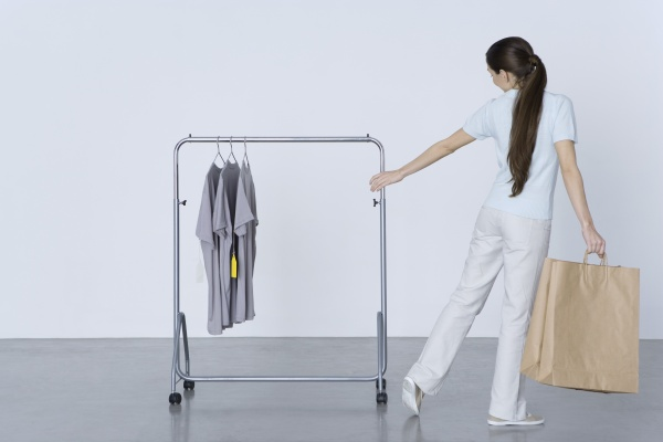 woman carrying shopping bags and reaching