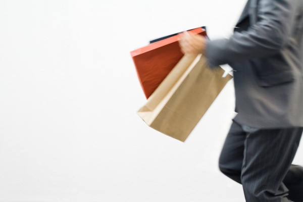 man running with shopping bags