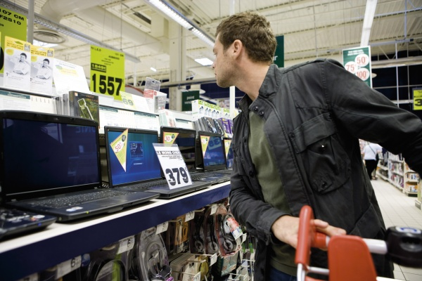 man shopping for laptop computers