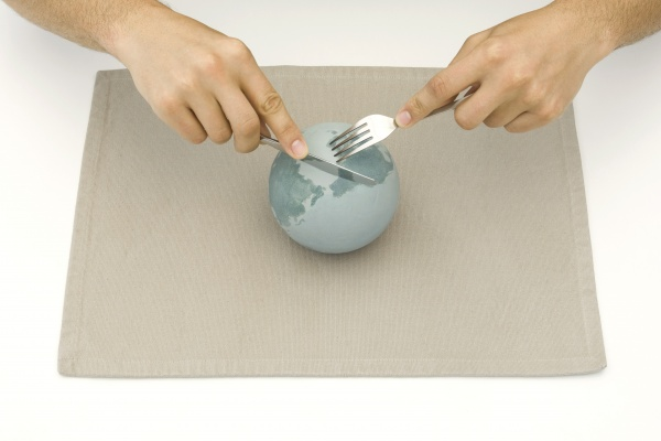 globe resting on placemat hands using