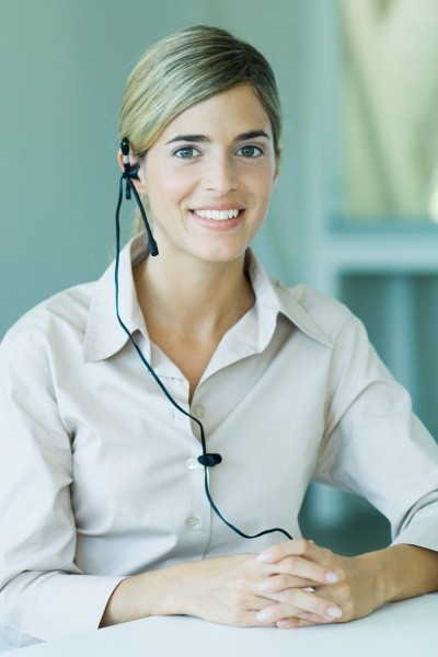 young businesswoman wearing headset smiling at