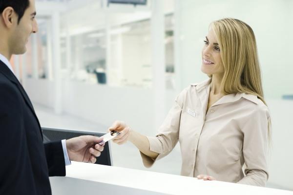 customer handing credit card to customer