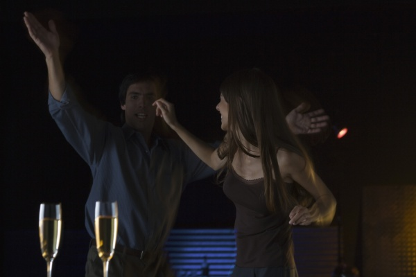 couple dancing in nightclub glasses
