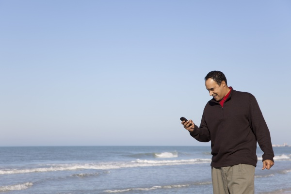 man looking text messaging on cell