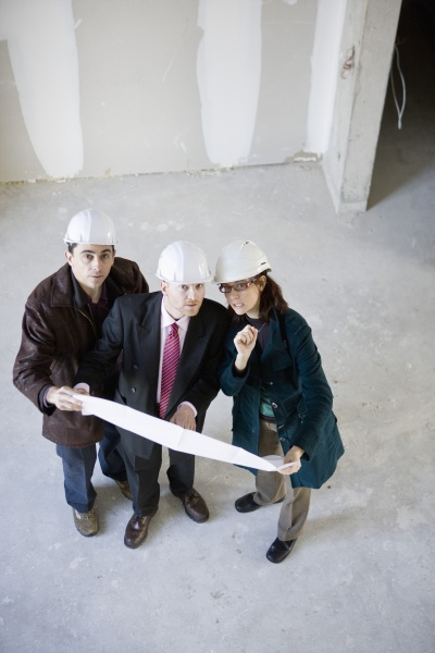 building contractor and business people discussing