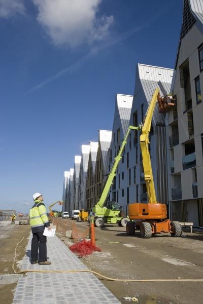 construction supervisor assessing construction site
