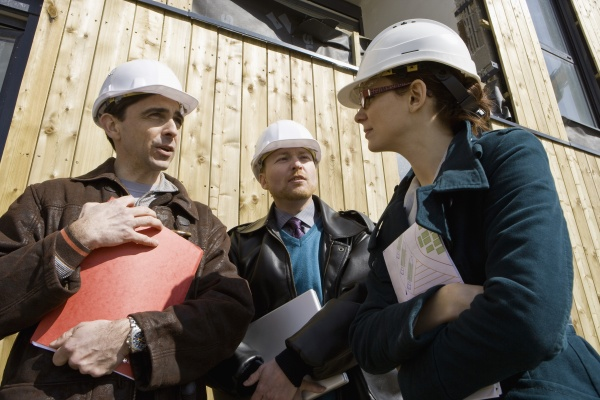 building contractor talking to business people
