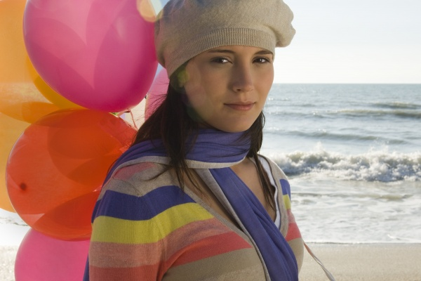 preteen girl with bunch of balloons