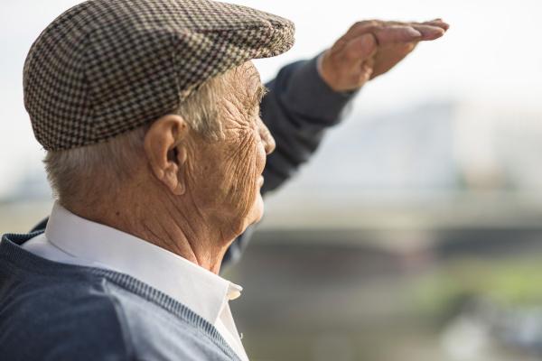 senior man wearing cap outdoors