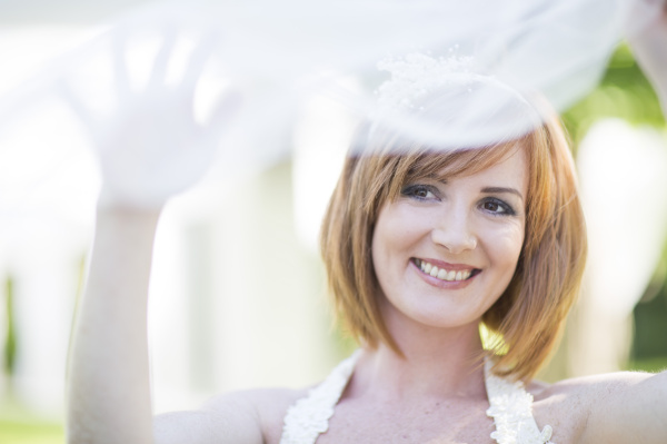portrait of smiling bride with veil