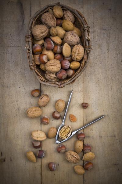 wickerbasket walnuts almonds hazelnuts and nutcracker