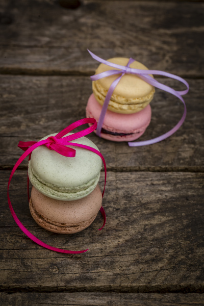 two stacks of different macarons