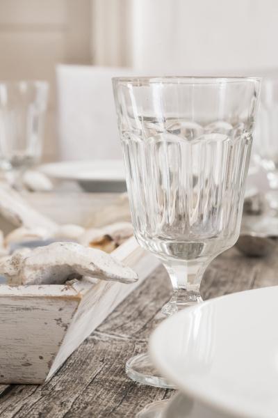 empty wine glass on maritime laid