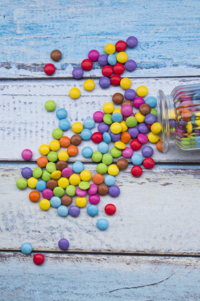 smarties and candy jar on light