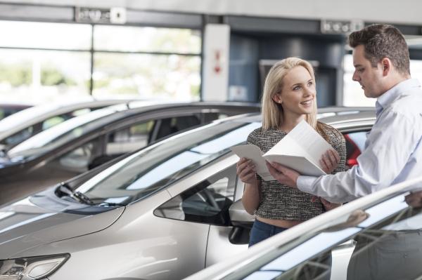 car dealer explaining new car to