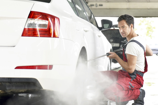 car cleaning man cleaning car with