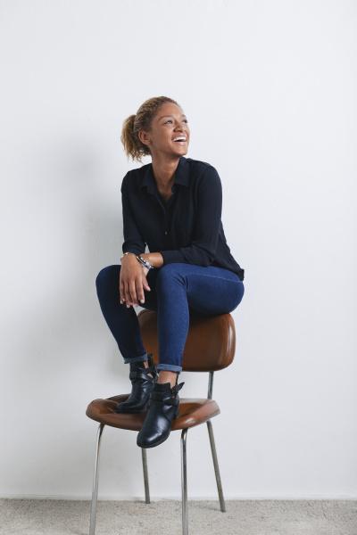 portrait of smiling woman on backrest