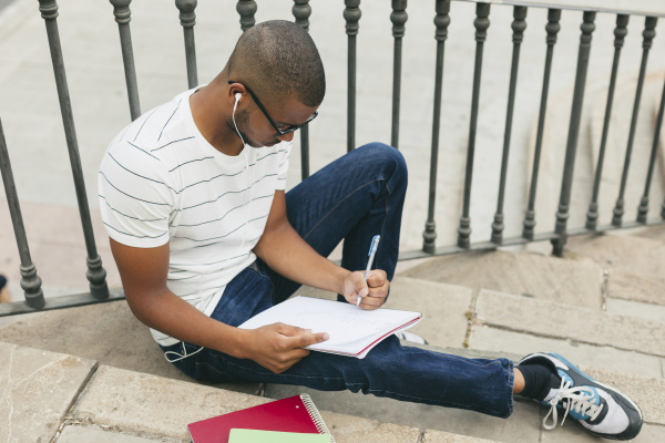 young afro american man studying language