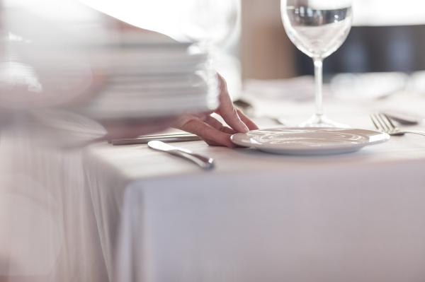 restaurant staff setting tables