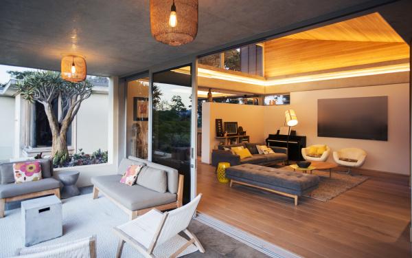 illuminated living room open to patio