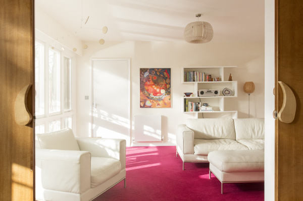 sunny living room with white leather