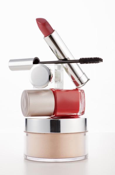 lipstick mascara and fingernail polish stacked