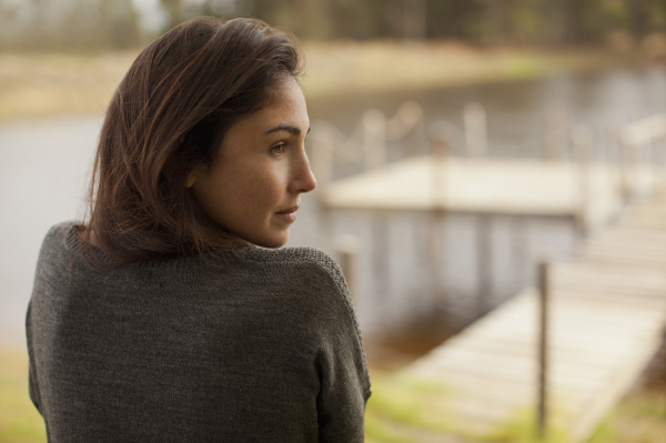pensive woman at lakeside