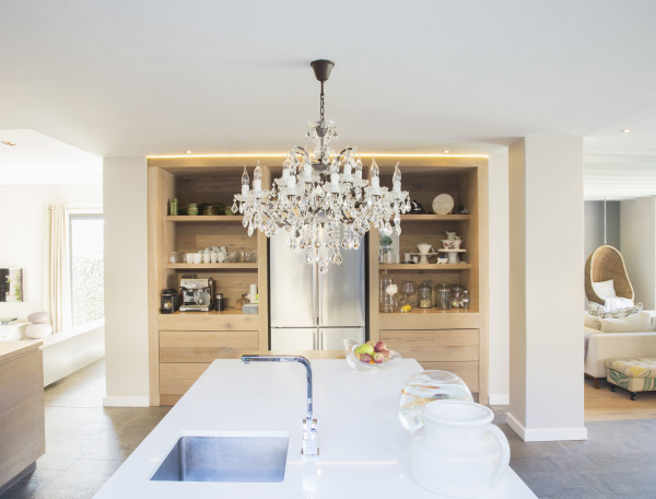 chandelier hanging over luxury kitchen island