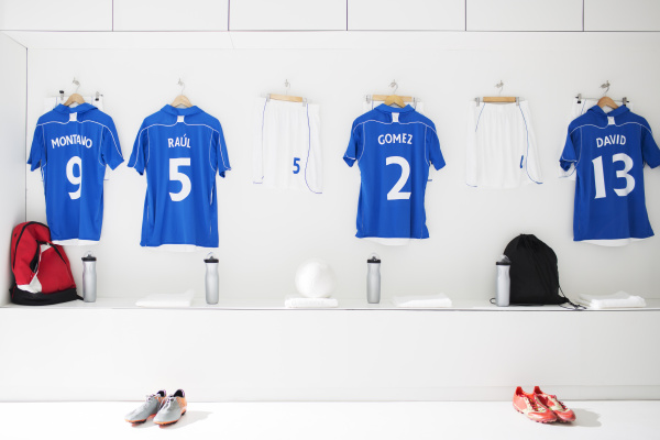 soccer team uniforms in locker room