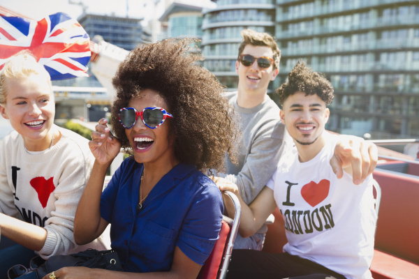 portrait enthusiastic friends with british flag